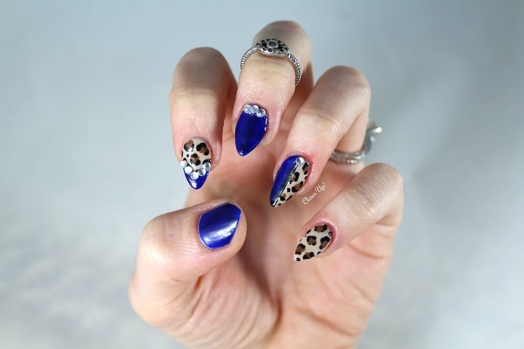 Electric blue leopard print nail art with bling