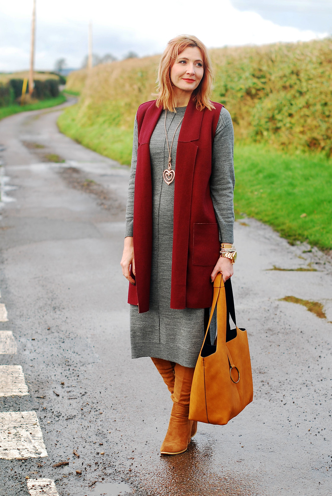 Winter layers: Burgundy sleeveless coatigan  grey midi sweater dress  tan over the knee (OTK) boots  ochre slouch hobo bag  rose gold heart pendant | Not Dressed As Lamb, over 40 style blog