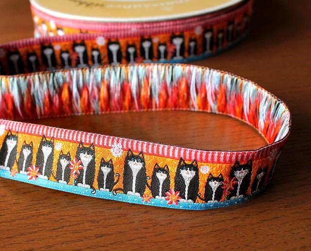 Renaissance Ribbons Black Cats on Orange