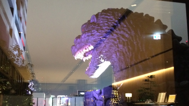 Godzilla through window