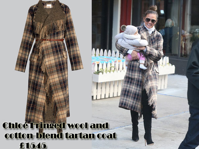 Chrissy-Teigen-in-Chloé-Fringed-wool-and-cotton-blend-tartan-coat, navy, beige, white and scarlet tartan jacket,  Chloé Fringed wool and cotton-blend tartan coat, tartan print coat, long coat, tartan long coat, winter coat, winter style, tonal-brown, navy, orange and beige mid-weight wool coat, white turtleneck, black thigh high jeans, gold hoop earrings, white turtleneck