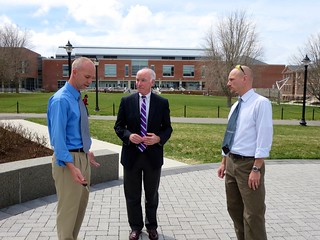 Mike Dietz, left, and Dave Dickson, right, take Congressman Joe Courtney on a tour highlighting UConn's innovative storm water management practices.