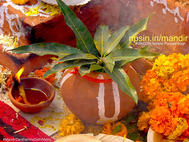 Holy water kalash pure as Gangajal with mango tree leaves and illuminated Deepak near yagyashal(Hawan Kund).