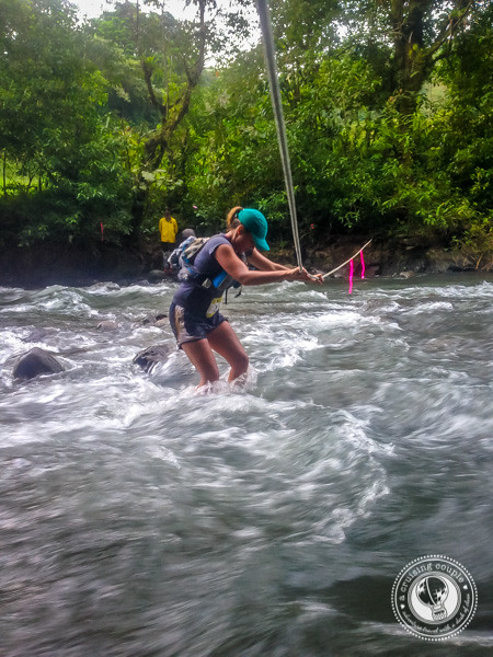 Crossing the river during the Moon Run in Monteverde, Costa Rica