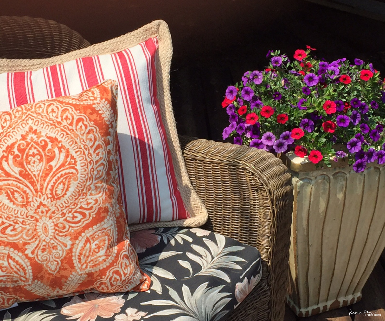 bright summer cushions dress up an outdoor wicker set