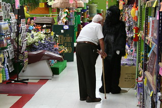Older Gentleman Smelling Gorilla Suit | by zoomar