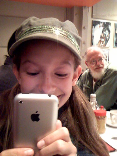 Coco and Tom at Saul's with two iPhones | by scriptingnews