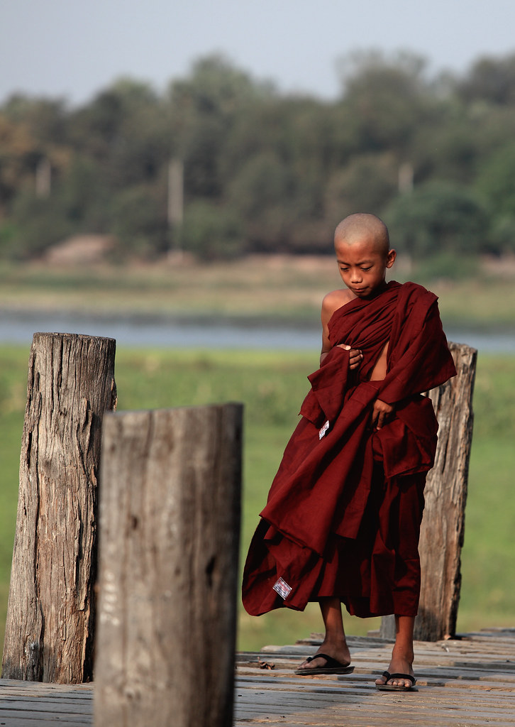 A Novice Monk Crosses The U Bein Bridge, Burma
