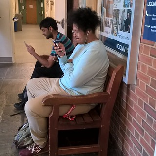 Students with mobile devices