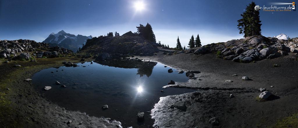 Full moon between Mt. Shuksan and Mt. Baker