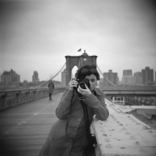 nathalie (and her leica) on the brooklyn bridge | by davidteter