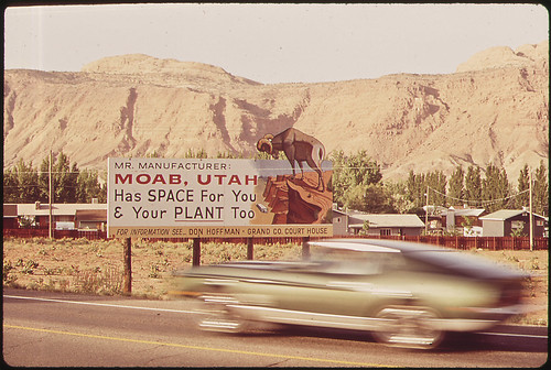 Sign Outside Moab, an Old Mormon Pioneer Town Situated on the Colorado River, Invites Industrial Expansion. The Region Is Rich on Oil, Uranium, and Potash. The Last Two Form the Basis of the Two Leading Industries of the Area, 05/1972 | by The U.S. National Archives