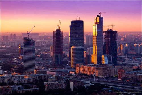 Cityscape with skyscraper construction at sunrise | by Dmitry Mordolff