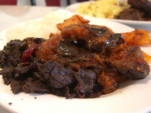 Plain rice with crisp beef lungs, sambal eggplant and curried potatoes ...