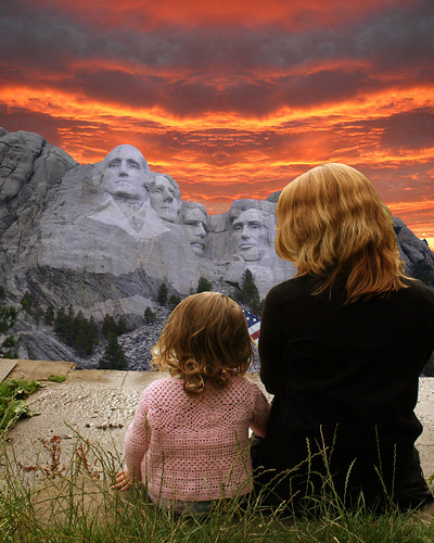 Mother and daughter chat in front of the Mount Rushmore National Memorial