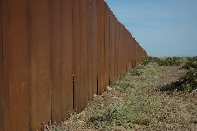 The Wall, US border, separating Mexico from the US, looking east, along Highway 2, Sonora Desert, Mexican side