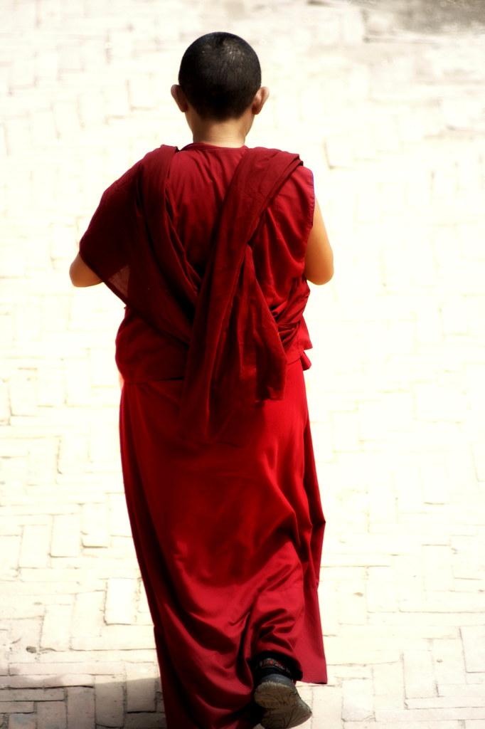 A Buddhist Monk Circumambulating The Bodhnath, Nepal