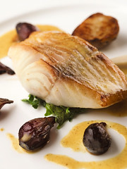 sablefish in curry butter with sunchoke purée and roasted pearl onions | by scout.magazine