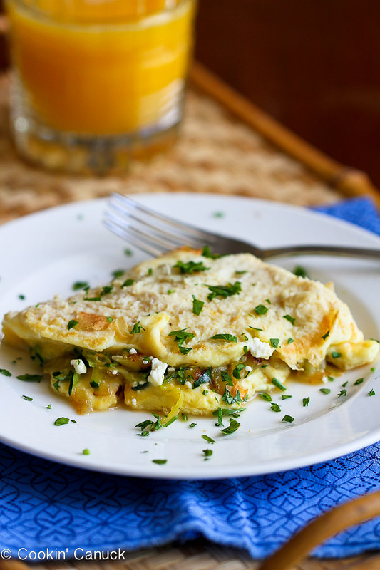 Zucchini, Onion and Feta Cheese Omelet Recipe...Tons of flavor in less than 20 minutes!   cookincanuck.com #vegetarian #MeatlessMonday #breakfast