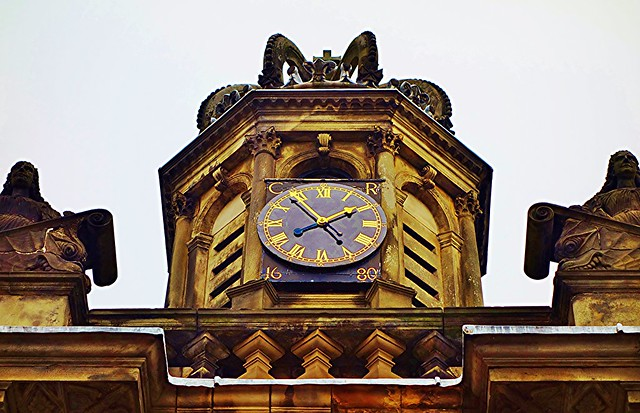 Clock at Palace of Holyroodhouse, Edinburgh, Scotland.