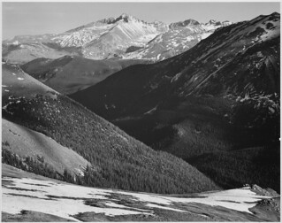 "Close in view, dark shadowed hills in foreground, mountains in background, ""Long's Peak, Rocky Mountain National Park,"" Colorado. 