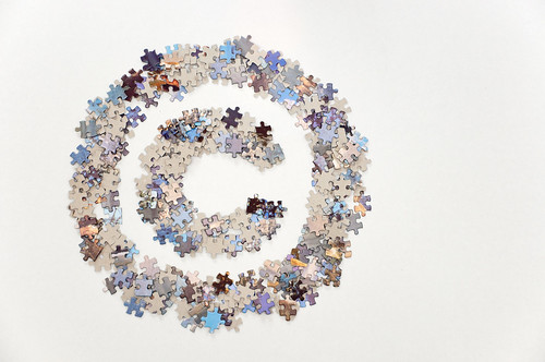Large copyright sign made of jigsaw puzzle pieces | by Horia Varlan