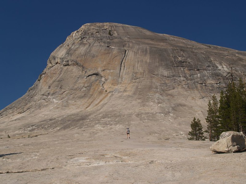 Vicki climbing the ever-steepening lower granite slope on Lembert Dome