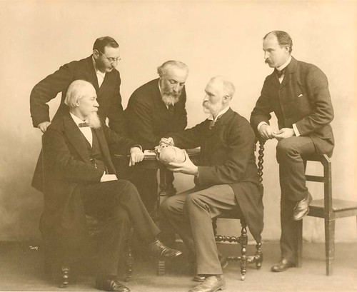 Sir William Macewen (1848-1924) with Adolph Barkan (1845-1935), Stanley Stillman (1861-1935).  Levi Cooper Lane (1828-1902),  Joseph Oakland Hirschfelfer (1854-1920) demonstrating Macewen's triangle | by Stanford Medical History Center