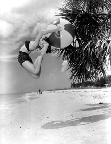 Barbara Hughes cutting a back flip with beach ball (black ballet fashion): Saint Petersburg Beach, Florida | by State Library and Archives of Florida