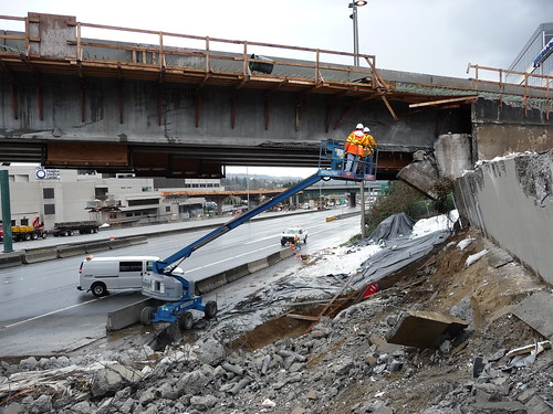 Crews inspect new NE 12th Street Bridge. The bridge was damaged during removal of the old  bridge | by WSDOT