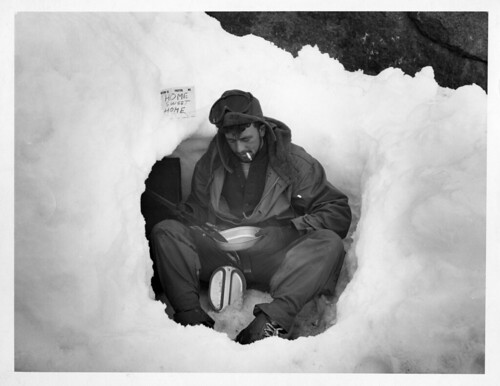 Operation Windmill Member Sitting in the Snow | by Smithsonian Institution