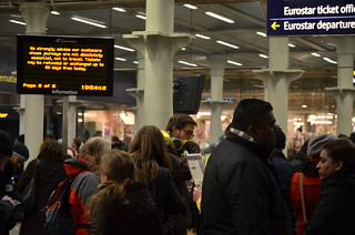 Fed-up looking passengers waiting in the mile-long queue at St Pancras International | by Ben Sutherland