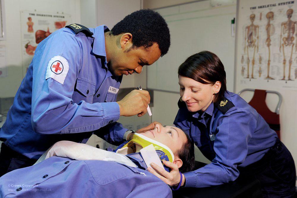 Royal Navy Medics Treating a Patient