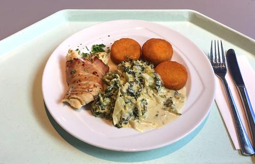 Codfish im smoked ham with savoy & potato thalers / Kabeljau in geräuchertem Schinken mit Wirsinggemüse & Kartoffeltalern