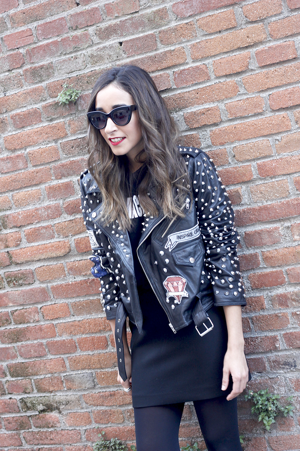 Leather jacket with studs and patches black skirt heels style fashion outfit12