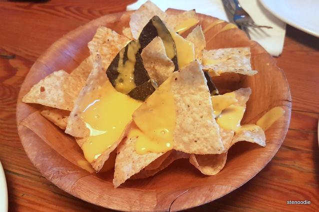 Complimentary cheesy nachos
