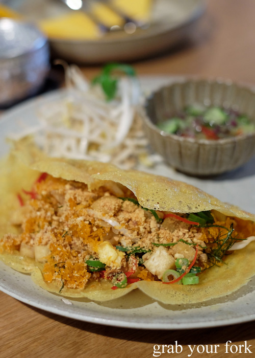Khanom bueng youan prawn and tofu turmeric crepe at Chat Thai at Gateway Sydney in Circular Quay