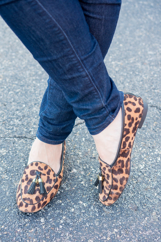 black sweater + fleece fur vest + jeans + leopard print loafers | Style On Target blog