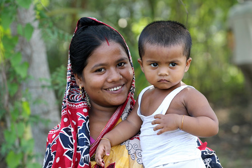 Woman farmer with her son in Khulna, Bangladesh. Photo by M. Yousuf Tushar. April 18, 2014