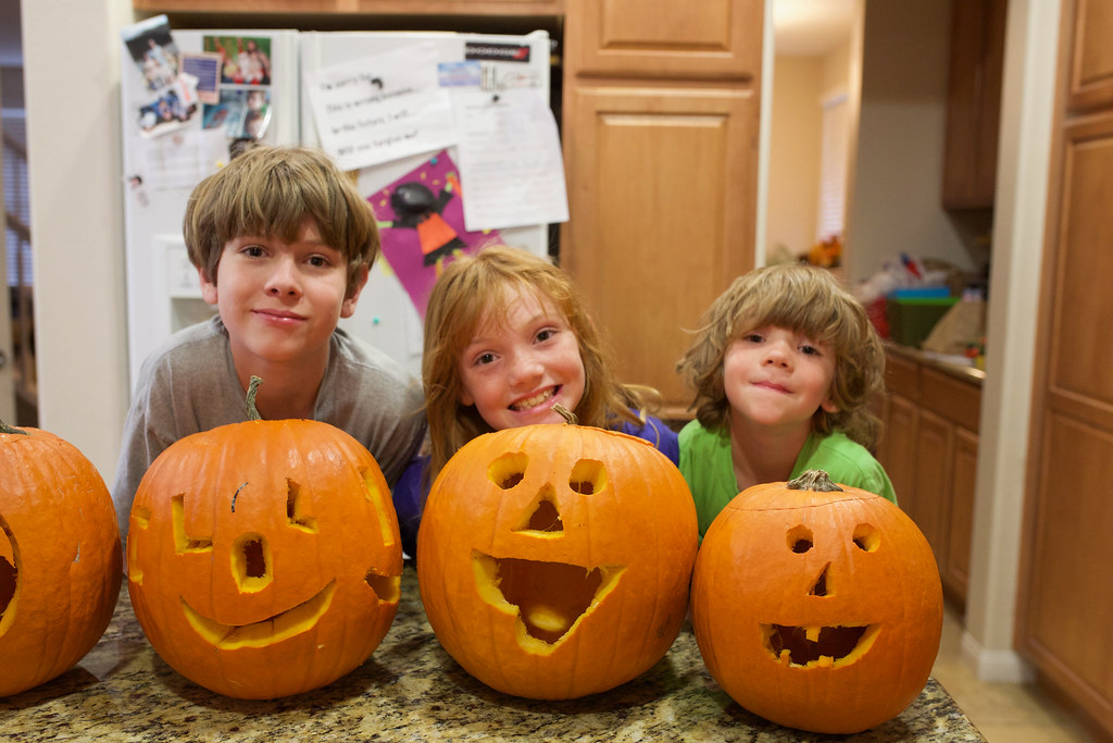 Kids carve pumpkins