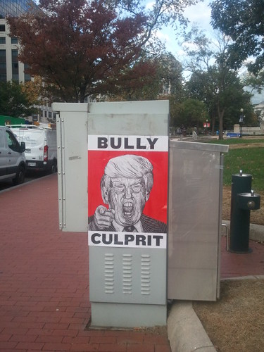 Anti Trump poster, Bully Culprit, on a traffic signal box in the Mount Vernon Triangle area of Downtown DC