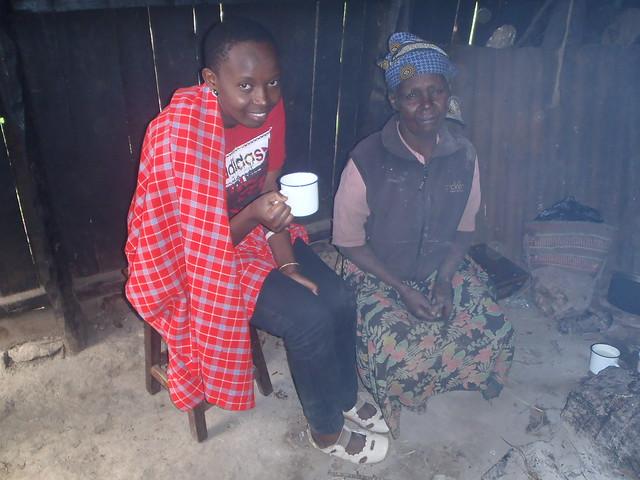 Winfred taking porridge with Njeri's grand mother