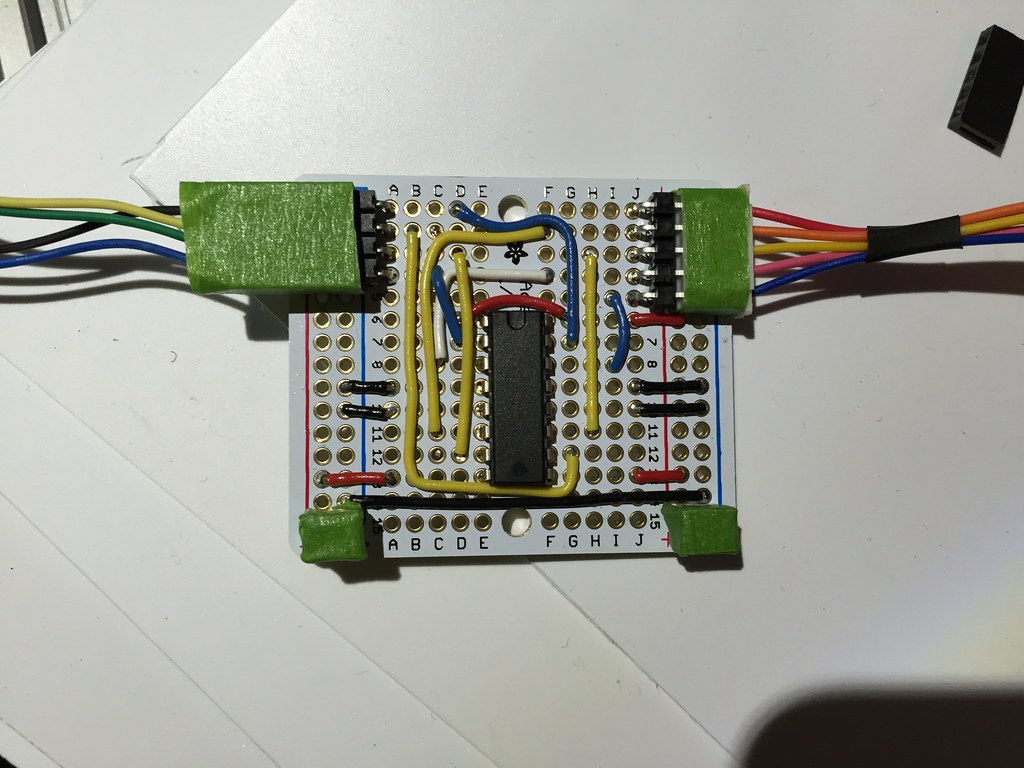Circuit board with connectors covered in painters tape