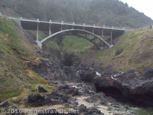 Perhaps the most impressive thing about the Spouting Horn Overlook at low tide is the US-101 bridge, Cape Perpetua, Oregon