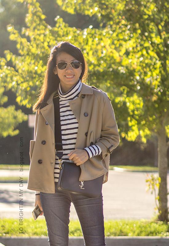 camel trench cape jacket, striped oversized turtleneck, skinny jeans, black crossbody bag with canvas strap