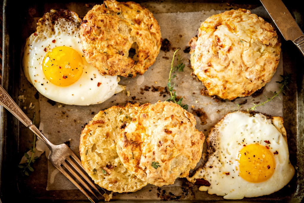These fast and easy Herb and Bacon Cottage Cheese Biscuits are the perfect by themselves or with a fried egg! | Recipe at GirlCarnivore.com
