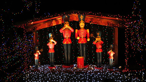 The Nutcracker Band surrounded by Christmas lights at Stanley Park's Christmas train (Vancouver)