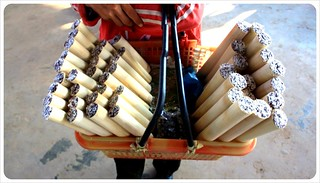 laos sticky rice vendor | by globetrottergirls