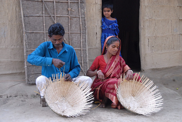Woman and her husband making baskets, Bangladesh. Photo by WorldFish, 2007