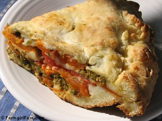Savory tomato, mozzarella, and basil pesto pie with an easy cheesy biscuit crust | by Farmgirl Susan